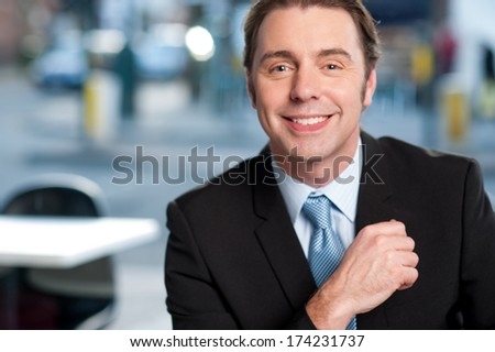 Handsome male manager at cafe - stock photo