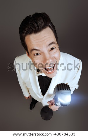 Handsome male singer, who plays in the style of the sixties. Rock'n'roll, jazz man. Nostalgia. - stock photo