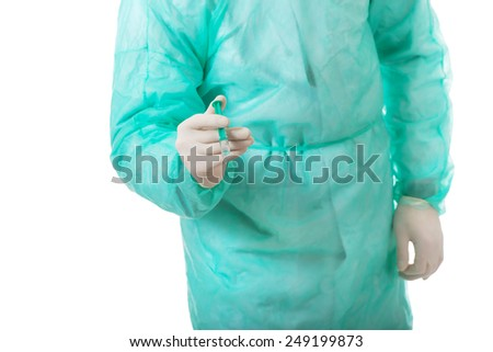 Handsome male surgeon doctor holding a syringe. - stock photo