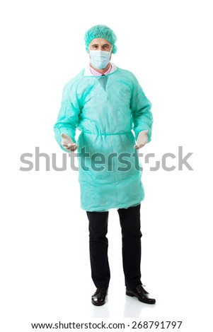 Handsome male surgeon holding a copyspace. - stock photo