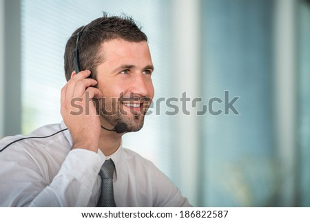 Handsome male telephone operator - stock photo