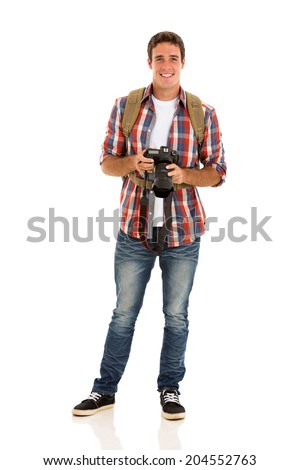 handsome male tourist with a camera on white background - stock photo
