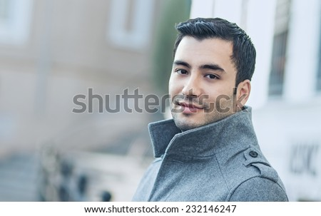 Handsome male wearing over coat, outdoor - outside. Autmn or winter coldly morning - stock photo
