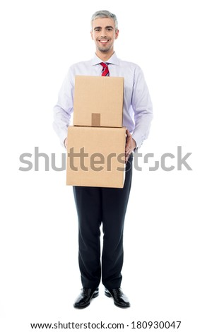 Handsome male with with stack of boxes isolated on white - stock photo