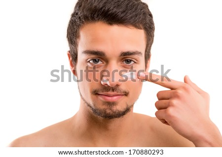 Handsome man applying - anti-aging concept - stock photo