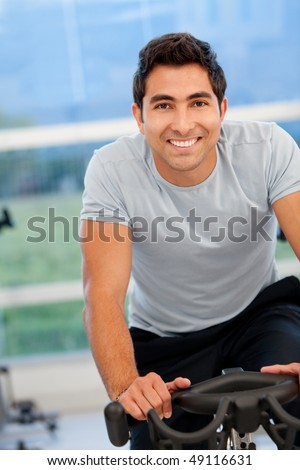 Handsome man at the gym - stock photo