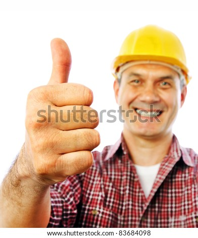 handsome man builder smiles and shows OK gesture with his hand - stock photo