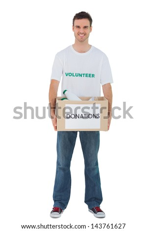 Handsome man carrying donation box with bottles on white background - stock photo