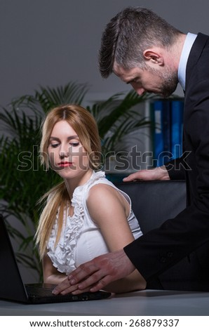Handsome man cheating at work with his young assistant - stock photo