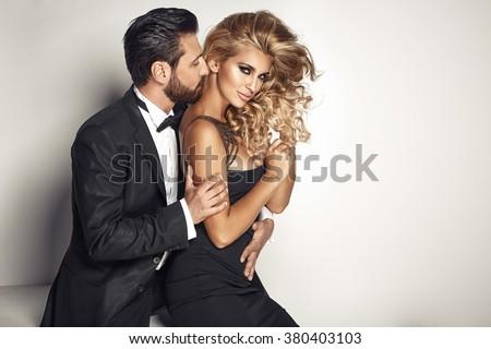 Handsome man cuddling his beloved woman - stock photo