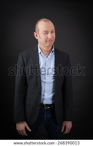 handsome man doing different expressions in different sets of clothes: blinking - stock photo