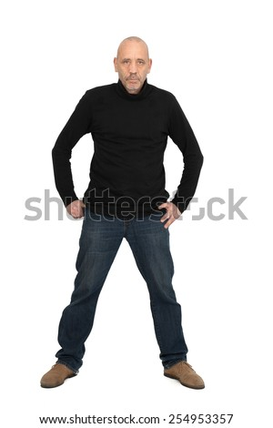 Handsome man doing different expressions in different sets of clothes: Full length posing - stock photo