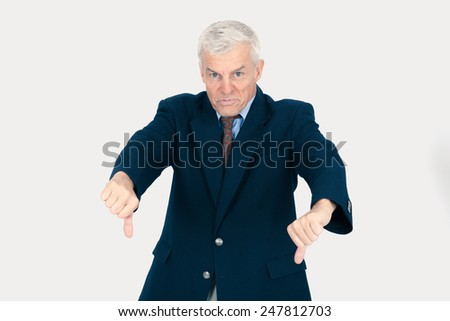 Handsome man doing different expressions in different sets of clothes: thumbs down - stock photo