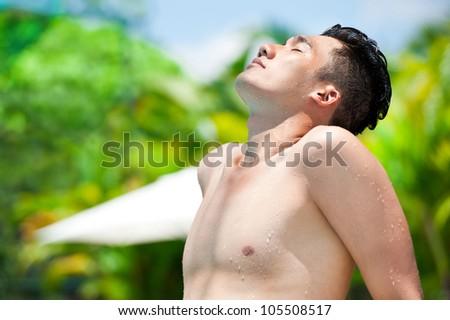 Handsome man enjoying the sun - stock photo