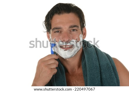 Handsome Man gets ready to shave - stock photo