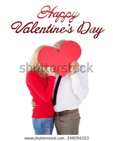 Handsome man getting a heart card form wife against cute valentines message - stock photo