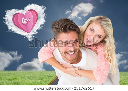 Handsome man giving piggy back to his girlfriend against cloud heart - stock photo