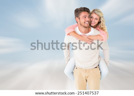 Handsome man giving piggy back to his girlfriend against cloudy sky - stock photo