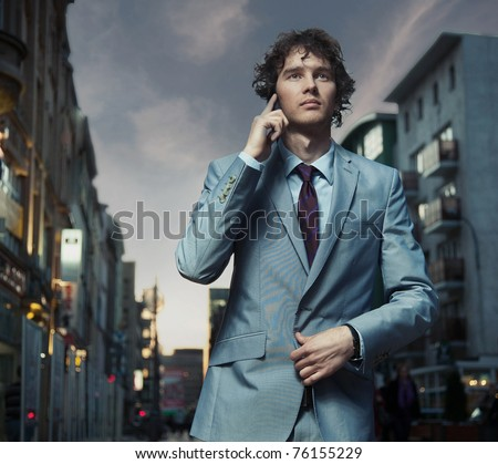 Handsome man going for meeting - stock photo