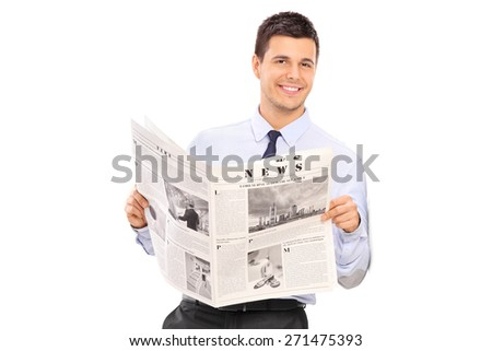 Handsome man holding a newspaper and leaning against a wall. The newspaper is custom made, the text is Latin and the pictures are my copyright. - stock photo