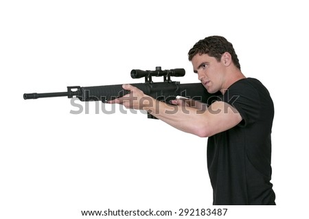 Handsome man holding an automatic assault rifle - stock photo