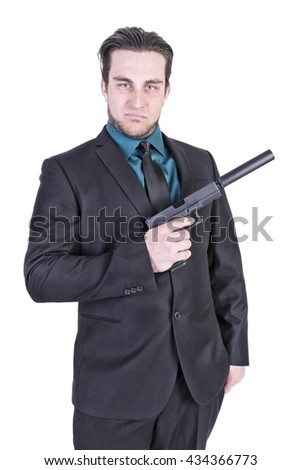Handsome man holding gun. Isolated on white background. - stock photo