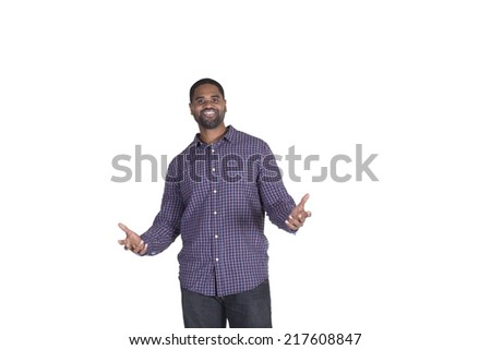 Handsome man holding his hands to his sides - stock photo