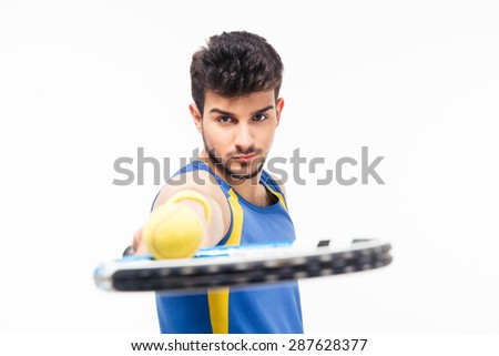 Handsome man holding tennis racket with ball isolated on a white background. Looking at camera - stock photo