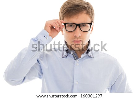 Handsome man in a blue shirt and glasses over a white background - stock photo