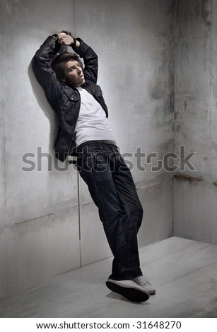 Handsome man in a melancholic mood - stock photo