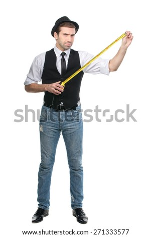 Handsome man in black hat rating the measure tape data. Isolated over white - stock photo