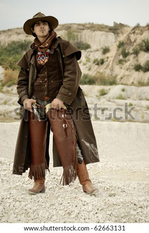 handsome man in cowboy clothes - stock photo