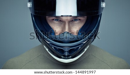 Handsome man in helmet on blue background - stock photo