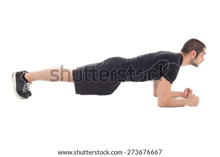 handsome man in sportswear doing exercises for abdominal muscles isolated on white background - stock photo