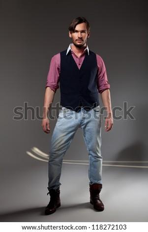 handsome man in studio - stock photo