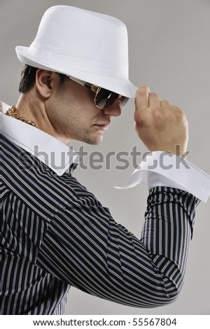 Handsome man in white hat - stock photo