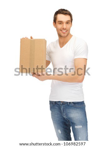 handsome man in white shirt with parsel - stock photo