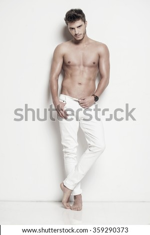 Handsome man in white trousers - stock photo
