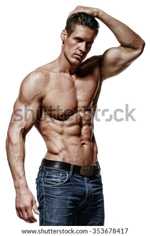 Handsome man is flexing his bicep. He is looking at the camera. Isolated on background - stock photo