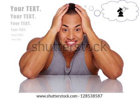 handsome man is fooling around by holding his head - stock photo