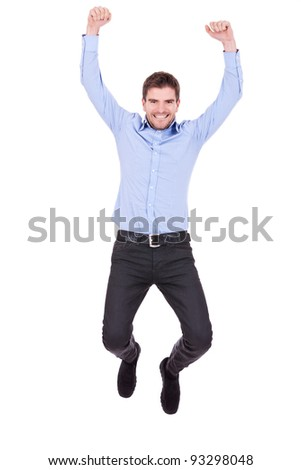 Handsome man jumping with vigor on white background - stock photo