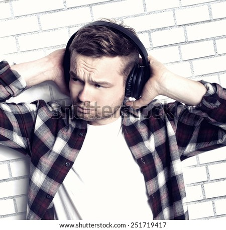 Handsome man listening music with headphones. - stock photo