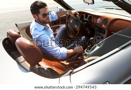 Handsome man near the car. Luxury life. - stock photo