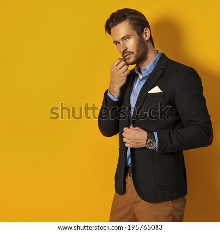 Handsome man on yellow background - stock photo