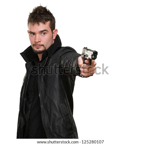 handsome man pointing with gun against a white background - stock photo
