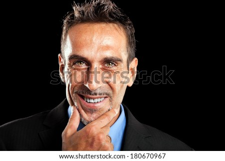 Handsome man portrait isolated on black  - stock photo