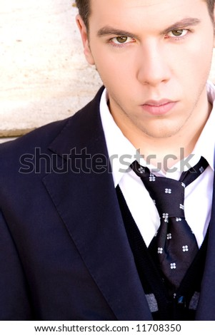 Handsome man portrait staring at camera - stock photo