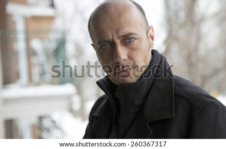 handsome man portrait taken outside at winter - stock photo
