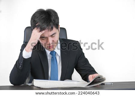 Handsome man reading a newspaper and serious - stock photo