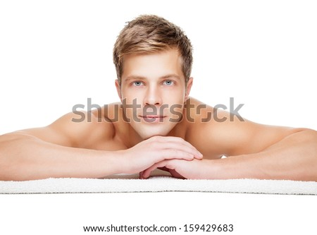 Handsome man ready for massage treatment isolated on white - stock photo